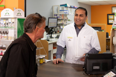 pharmacist talking to senior patient